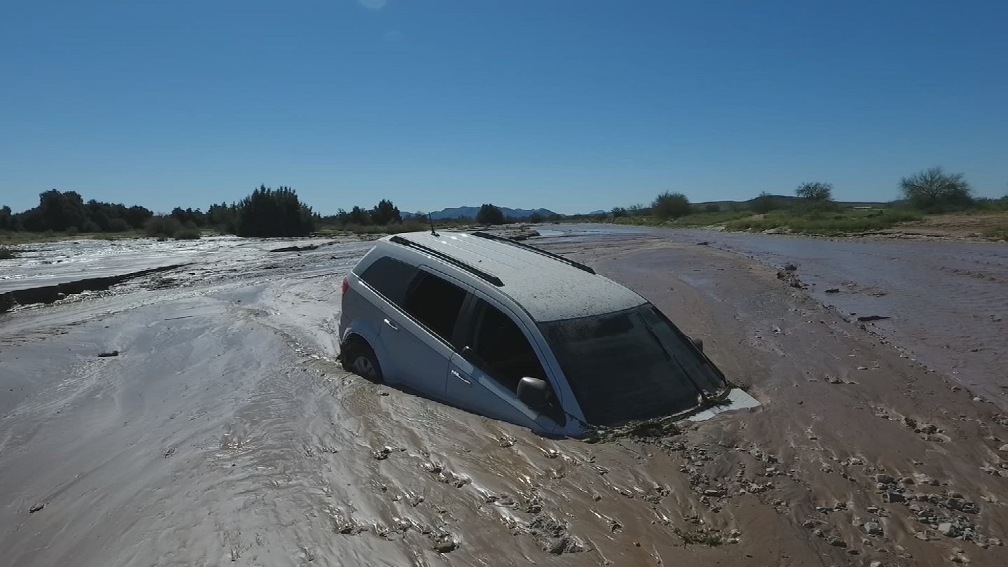 Dwight Music's vehicle is stuck in the mud after he drove down a flooded road. (Source: 3TV/CBS 5)