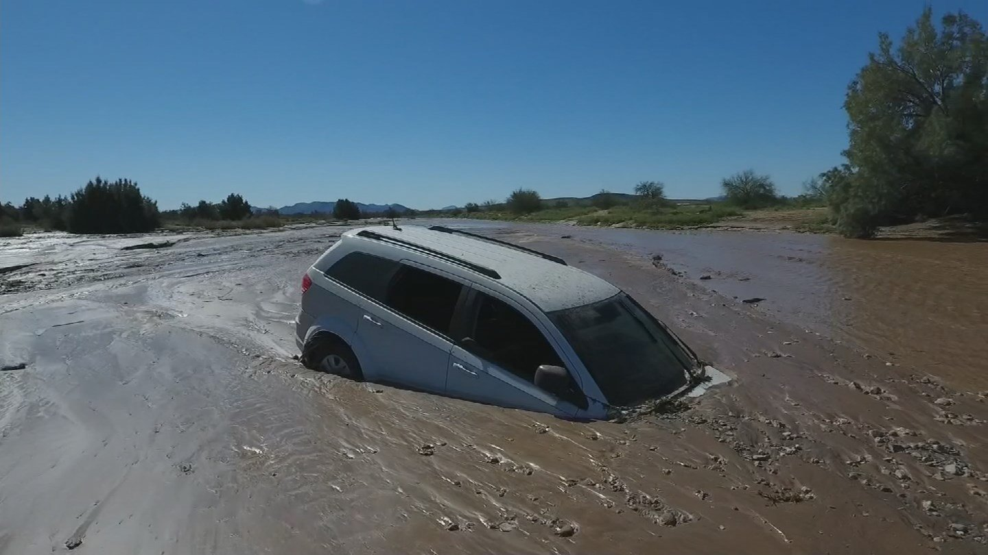 When the water receded on Tuesday, the man's car had been buried in mud. (Source: 3TV/CBS 5)