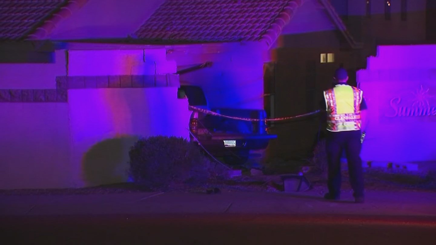 A suspected drunk driver slammed through a brick wall and into the house near 67th and Glendale avenues on Feb. 25. (Source: 3TV/CBS 5)