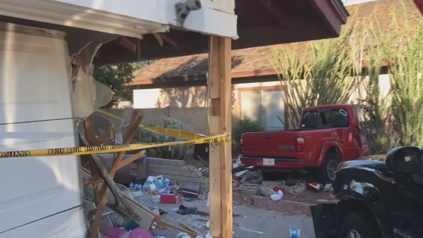A suspected drunk driver crashed into a Peoria house on Thursday. (Source: Peoria Police Dept.)