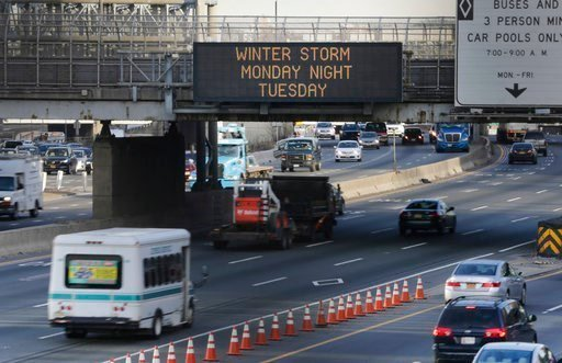 A sign warns motorists about an impending winter storm in Fort Lee, N.J., Monday, March 13, 2017. The Northeast is bracing for a blizzard expected to sweep the New York region with possibly the season's biggest snowstorm. (AP Photo/Seth Wenig)