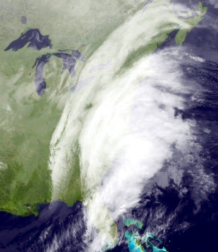 This satellite image taken around 12:12 a.m. EDT and released by the National Oceanic and Atmospheric Administration, shows clouds around the Northeast on Tuesday, March 14, 2017. (NOAA via AP)