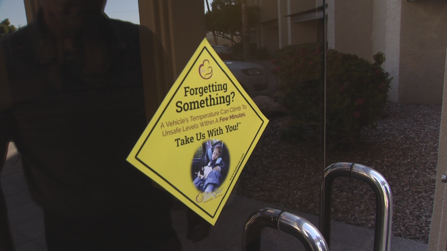 Lou Molinari created a sticker that he hopes businesses and homeowners will place on their doors, reminding caregivers to double check their car. (Source: 3TV/CBS 5)