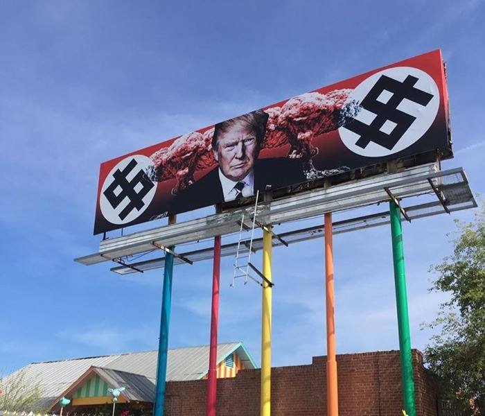 Billboard depicting Trump with mushroom clouds and swastika-like dollar signs pops up in Phoenix.  [Source: 3TV/CBS5 News]