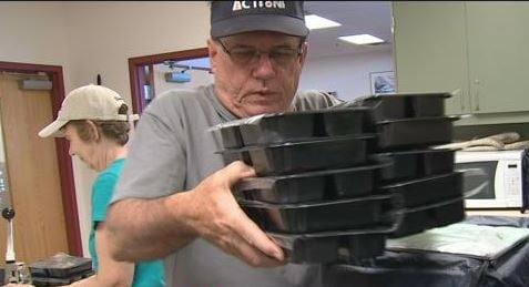 Meals being prepared for delivery by volunteers.  Friday 17 March 2017 [Source: 3TV/CBS 5]