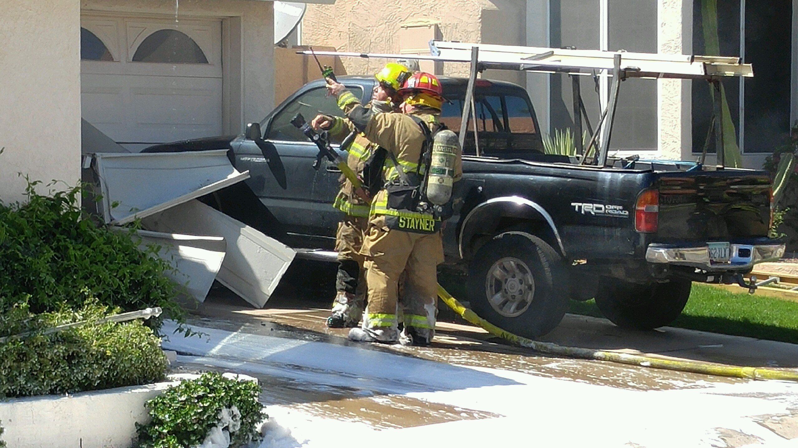 Phoenix Firefighters work on hot spots on a house fire Sunday.  19 March 2017[SOURCE: 3TV/CBS5 News]