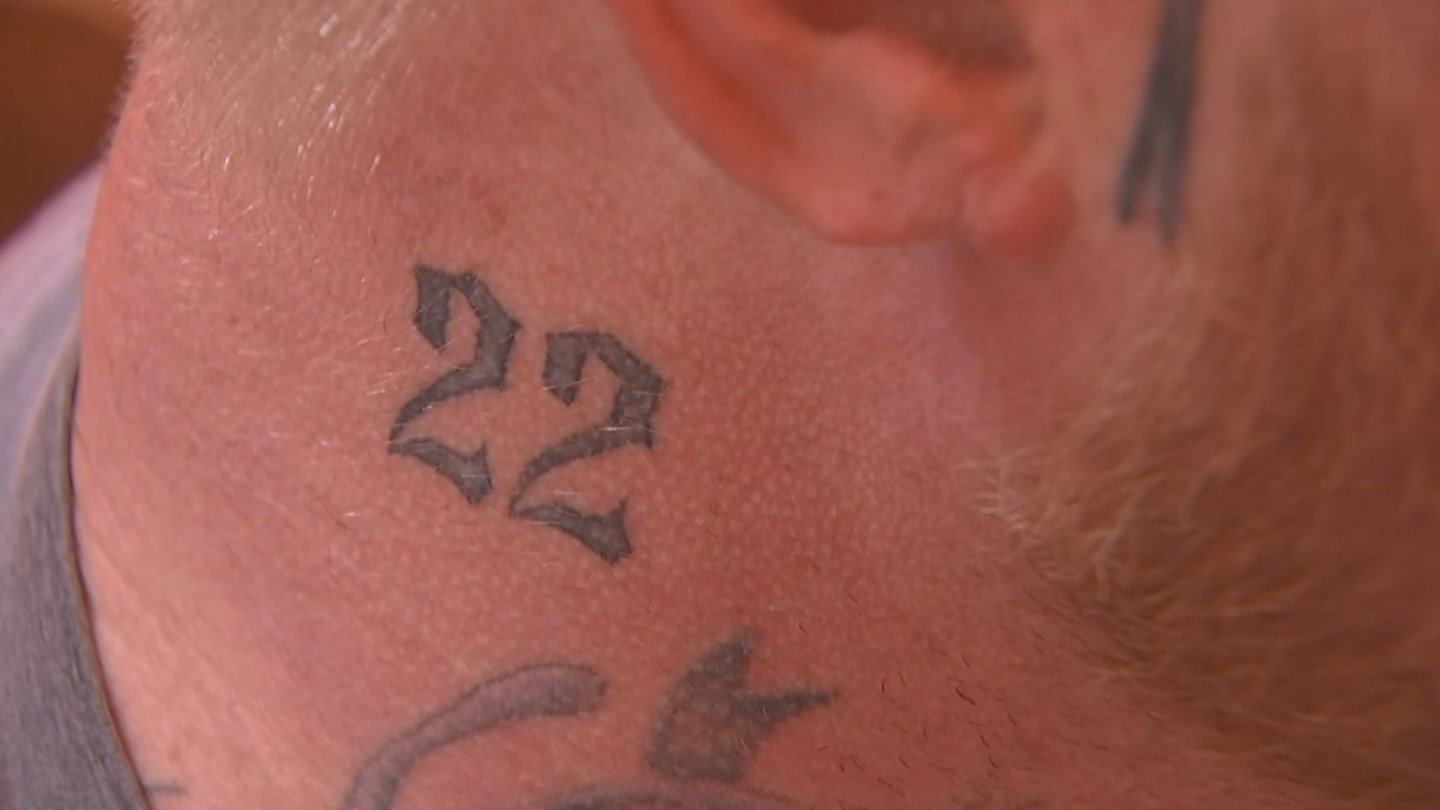 The tattoo in question is the number 22. It was perceived as something that could be gang related. (Source: 3TV/CBS 5)