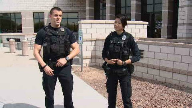 Officers David Ayres and Sarah Trieu played a pickup game with the boys. (Source: 3TV/CBS 5)