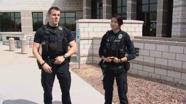 Officers DavidAyres and Sarah Trieu played a pickup game with the boys. (Source: 3TV/CBS 5)