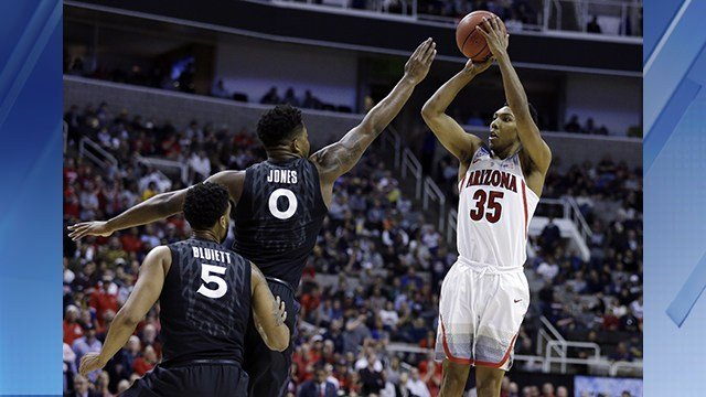 Arizona guard Allonzo Trier (35) shoots over Xavier forward Tyrique Jones (0) and Trevon Bluiett (5) during the first half of an NCAA Tournament college basketball regional semifinal game Thursday, March 23, 2017, in San Jose, Calif. (AP Photo/Ben Margot)