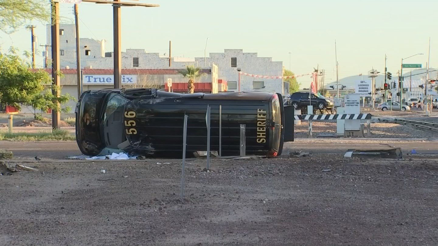 The MCSO transport van rolled several times, coming to rest on its side. (Source: 3TV/CBS 5)