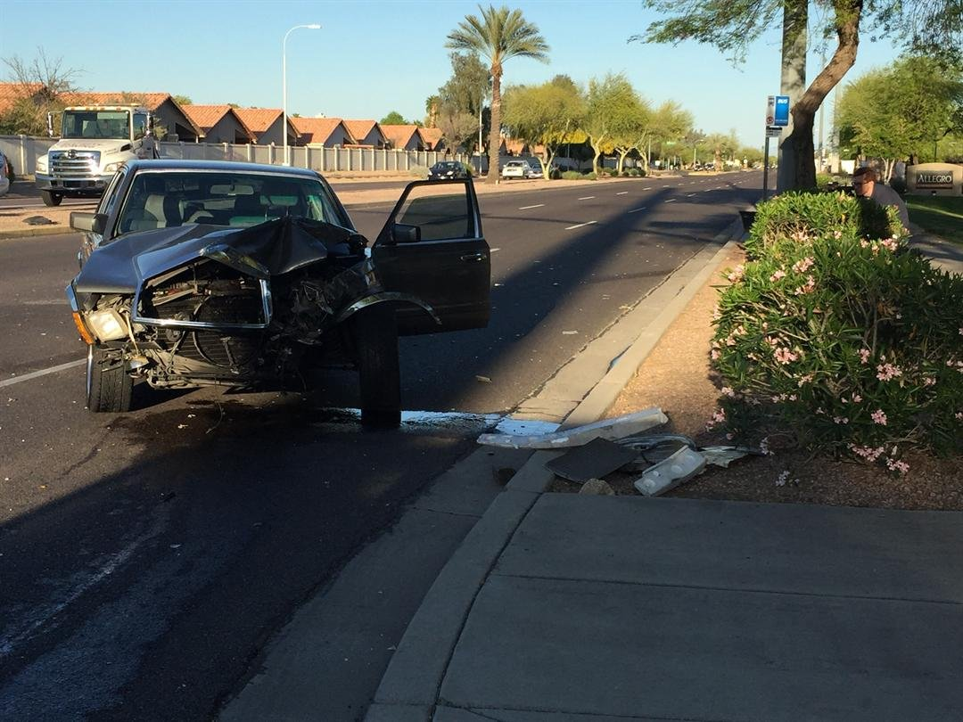 Two vehicles got into a crash in Ahwatukee and one of the cars hit a bus stop. (Source: 3TV/CBS 5)