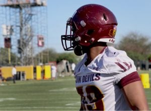 An ASU football player watches his teammates practice. TGen conducted a three-year study of Arizona State University football players to collect data on head injuries. (Source: Chelsey Ballarte/Cronkite News)