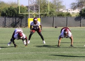 ASU linebacker Khaylan Thomas warms up with his team during practice. TGen conducted a three-year study of players to collect data on concussions. (Source: Chelsey Ballarte/Cronkite News)