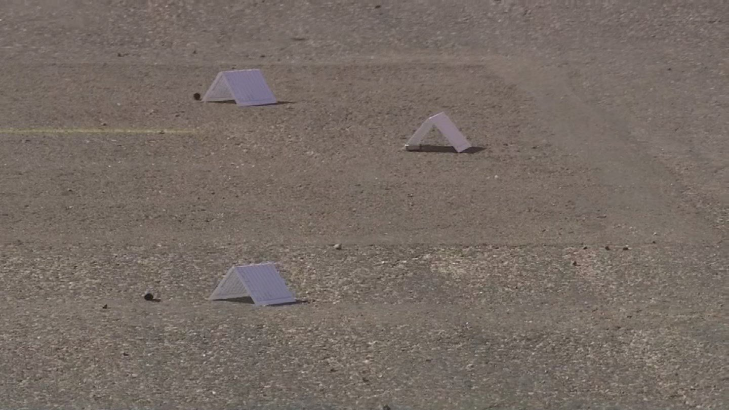 Bullet casing spread on the pavement at shooting in scene in  Mesa. (Source: 3TV/CBS 5)