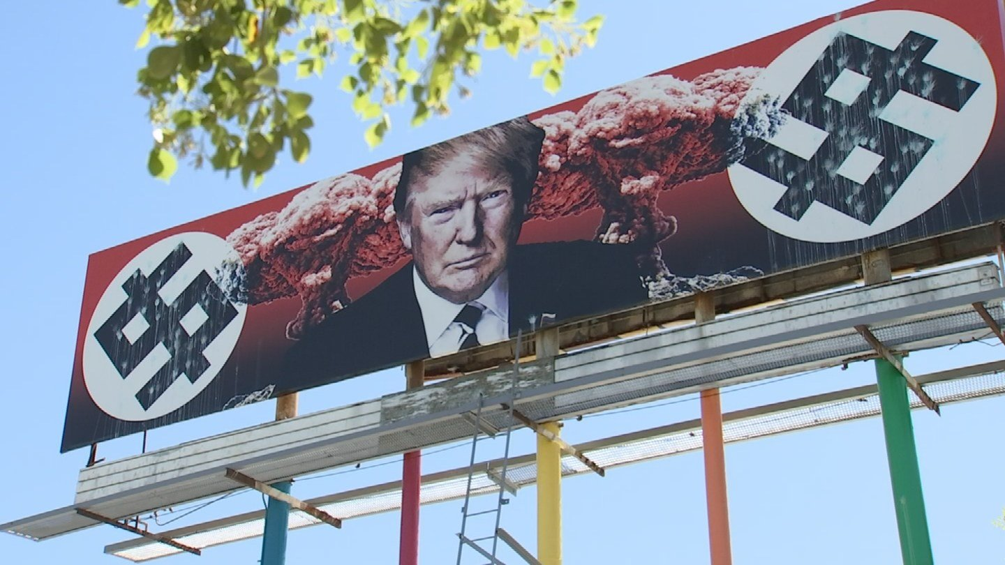 In this picture of the billboard from March 29, paintball vandalism can be seen. (Source: 3TV/CBS 5)