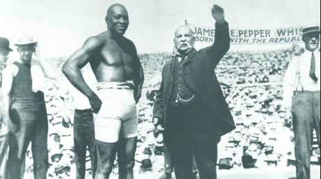Jack Johnson, the first black heavyweight boxing champion.