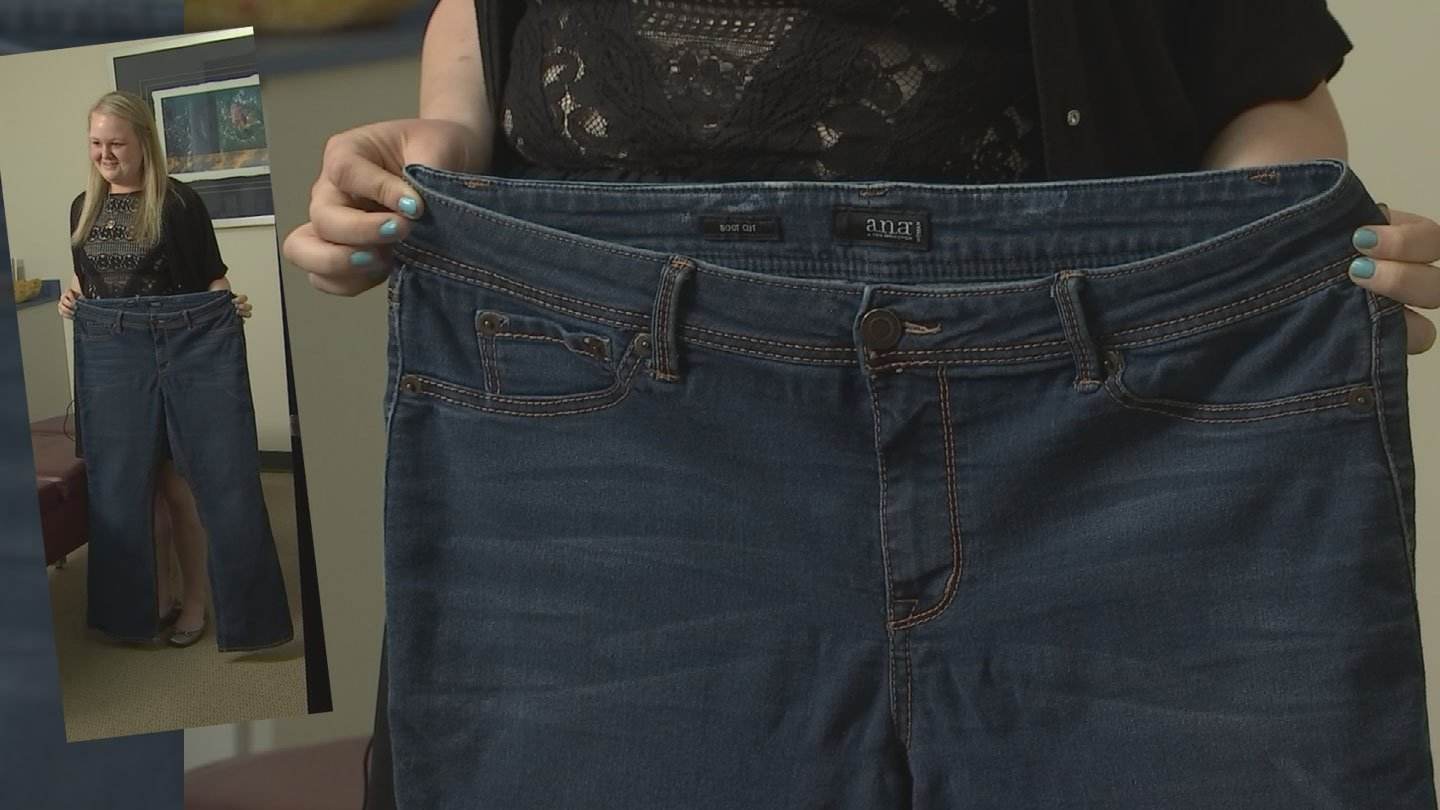 Madison Ryals shows the size 18 jeans she used to wear. (Source: 3TV/CBS 5)