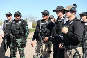 Gilbert Police Officers listened to an instructor during a rifle training course. Gilbert's police force was among the departments that more closely represented the Latino demographics of their city according to a Cronkite News analysis.