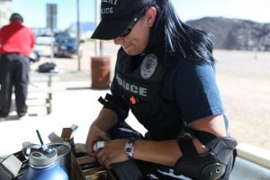 Gilbert Police Officer Denise Barajas reloads her rifle during a rifle training course in Apache Junction. (Source: Emily L. Mahoney/Cronkite News)