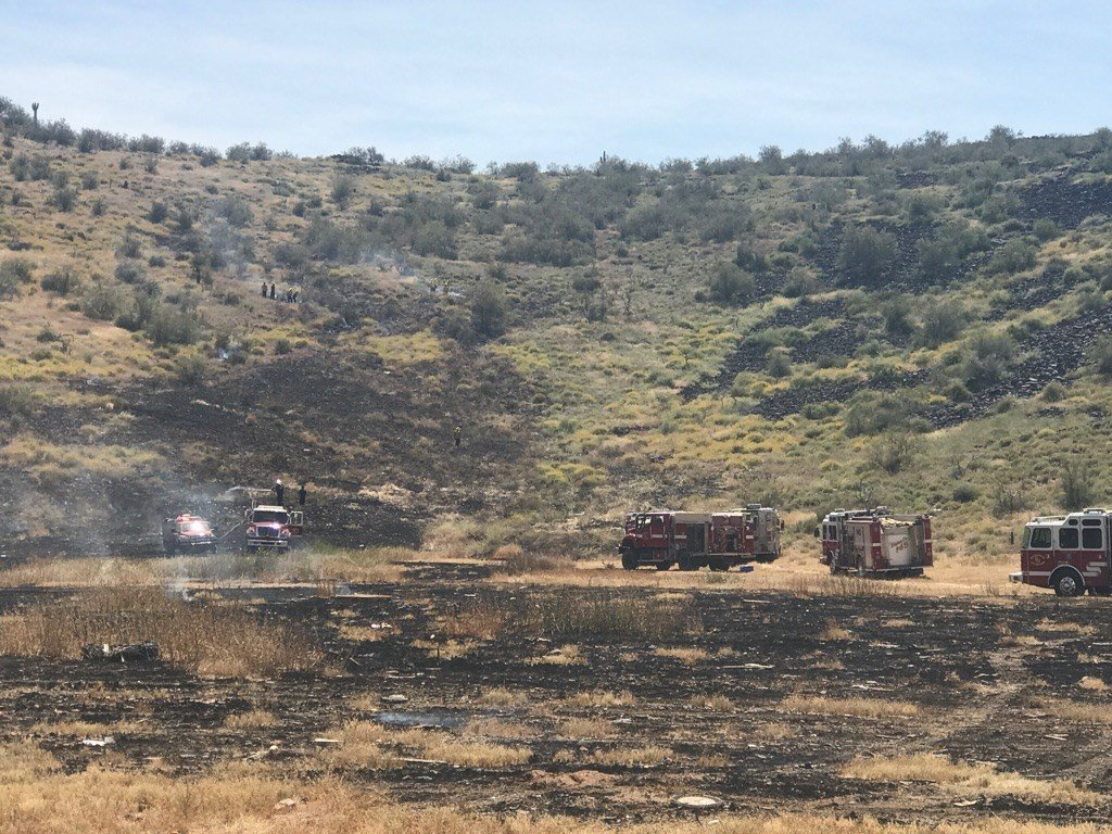 Phoenix and Daisy Mountain fire crews fighting a slow moving brush fire Sunday, April 9, 2017. (Source: Phoenix Fire Department)