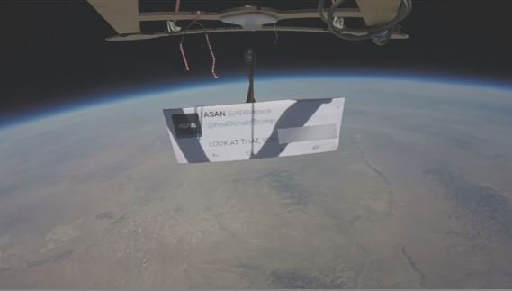 Protesters with ASAN launched a device up into space with a tweet as an anti-Trump demonstration. (Source: 3TV/CBS 5)