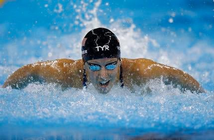 In this Aug. 6, 2016, file photo,'United States' Dana Vollmer competes in a women's 100-meter butterfly semifinal during the swimming competitions at the 2016 Summer Olympics, in Rio de Janeiro, Brazil.