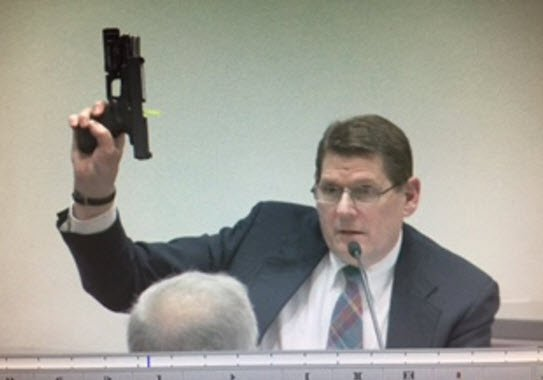 Terrence Weaver of DPS crime lab, holding up the gun used in the NAU shootings, for the jury to see. (Source: 3TV/CBS 5)