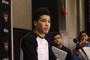 Suns guard Devin Booker talks to media during exit interviews at Talking Stick Resort Arena in Phoenix. (Source: Logan Newman/Cronkite News)