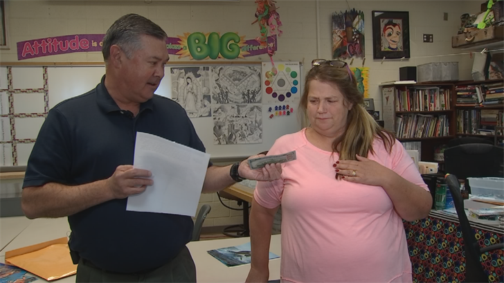 Parent Clint Potts Pays it Forward to Hamilton High School art teacher Karen Tabor. (Source: 3TV/CBS 5)