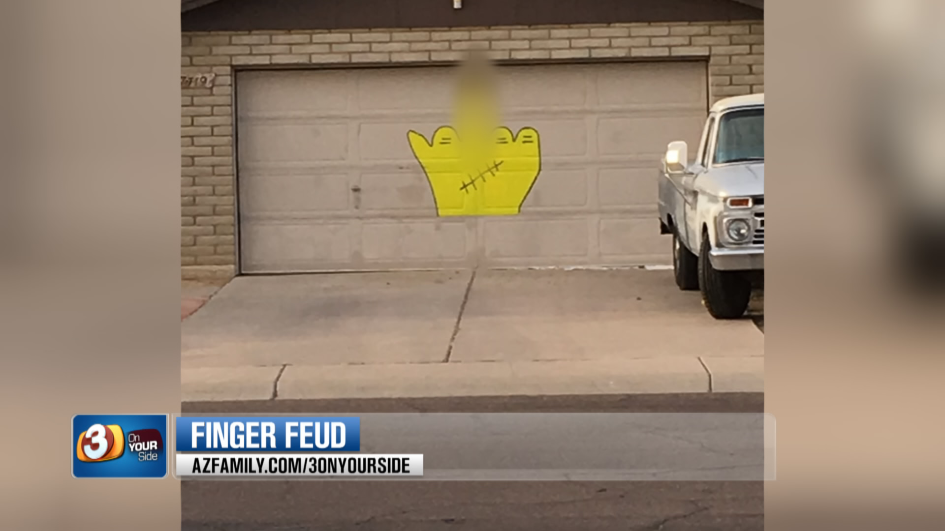 According to Ernie Leas, he painted a giant middle finger on the front of is garage door because of an ongoing feud with his neighbors that started 20 years ago. (Source: 3TV/CBS 5)
