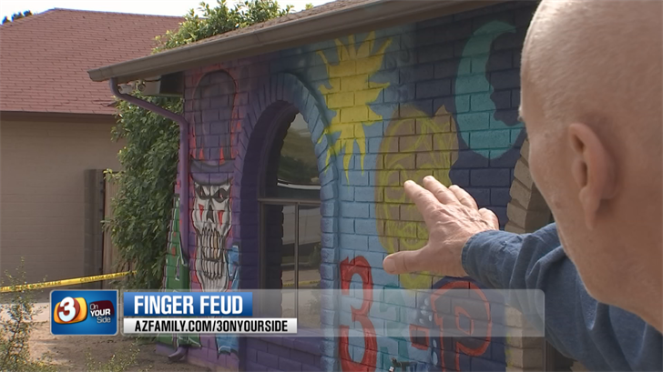 He's now getting underneath his neighbor's skin by having a professional artist paint a purple, graffiti-themed mural on the front of his brick home. (Source: 3TV/CBS 5)