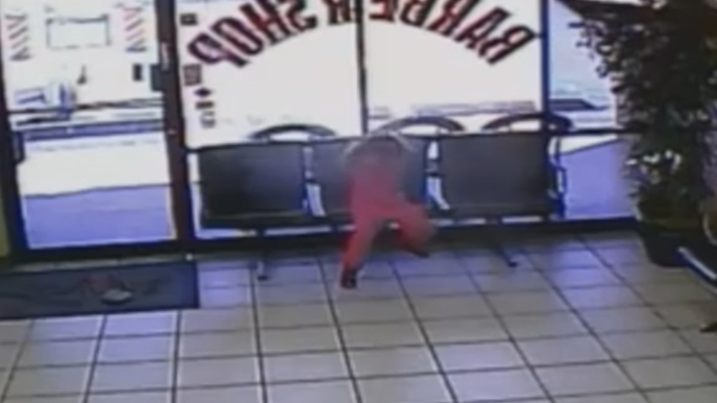 Surveillance video from barber shop captured the shooting. (Source: Chandler Police Dept.)