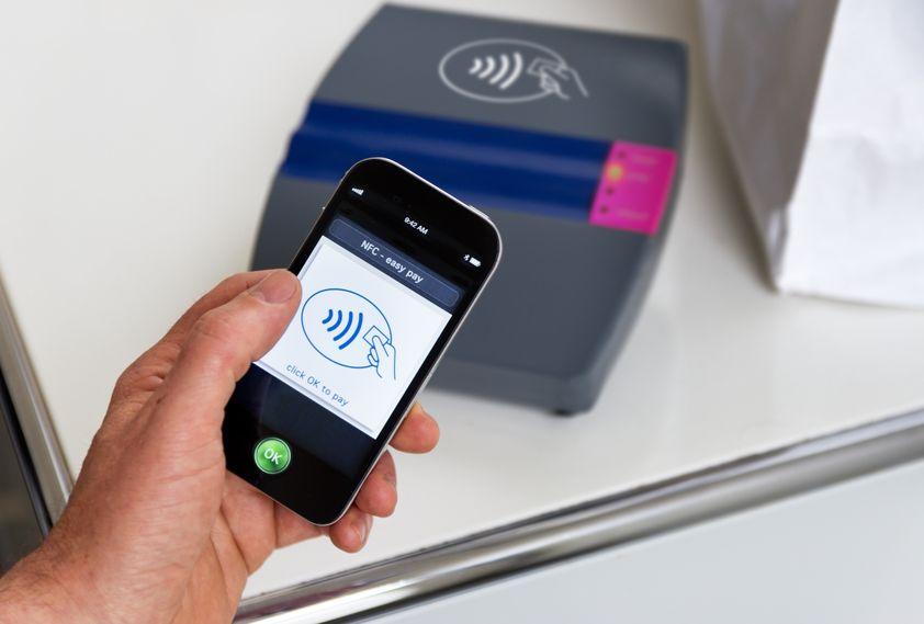 NFC (near field communications) payments via mobile phone (Source: Alexander Kirch via 123RF)