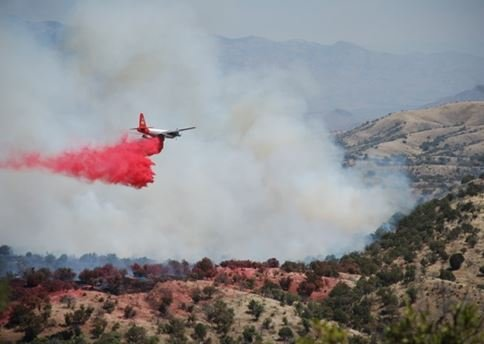 A tanker aircraft drops slurry on the Sawmill Fire on Monday, April 24. (Source: Jim Moutray via Tucson News Now)