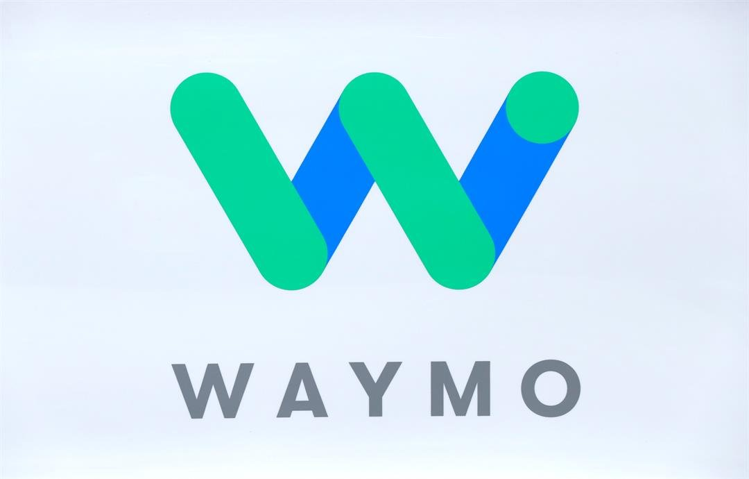 The Waymo logo is shown at the North American International Auto Show in Detroit, Sunday, Jan. 8, 2017. Waymo is the autonomous vehicle company created by Google's parent company, Alphabet. (AP Photo/Paul Sancya)