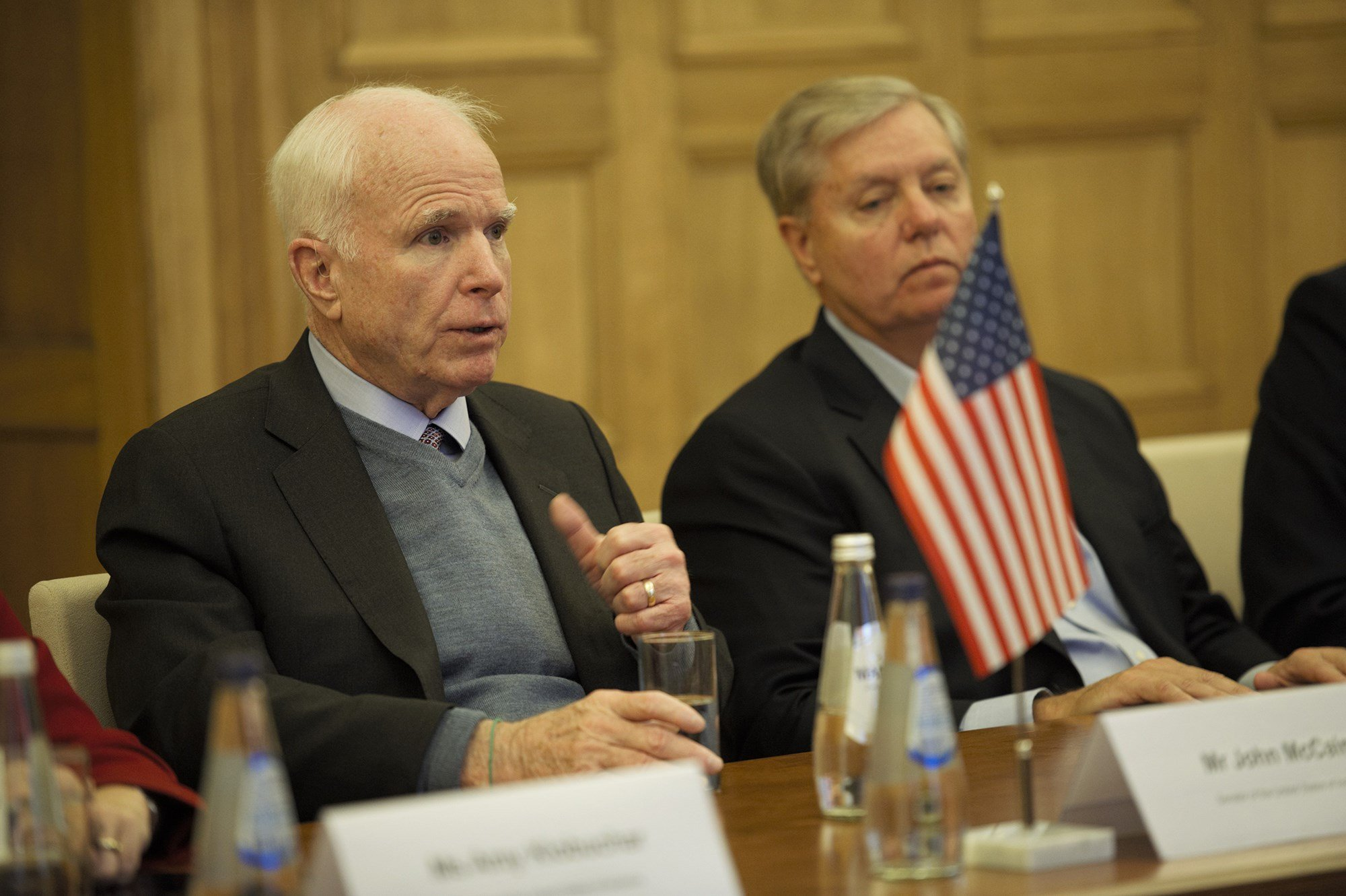 Sen. John McCain, R-Arizona, left, and Sen. Lindsey Graham, R-South Carolina, during a December visit to Latvia. The two men, frequent critics of President Donald Trump, were hosted by the president at a private White House dinner Monday. (Photo by Andrej