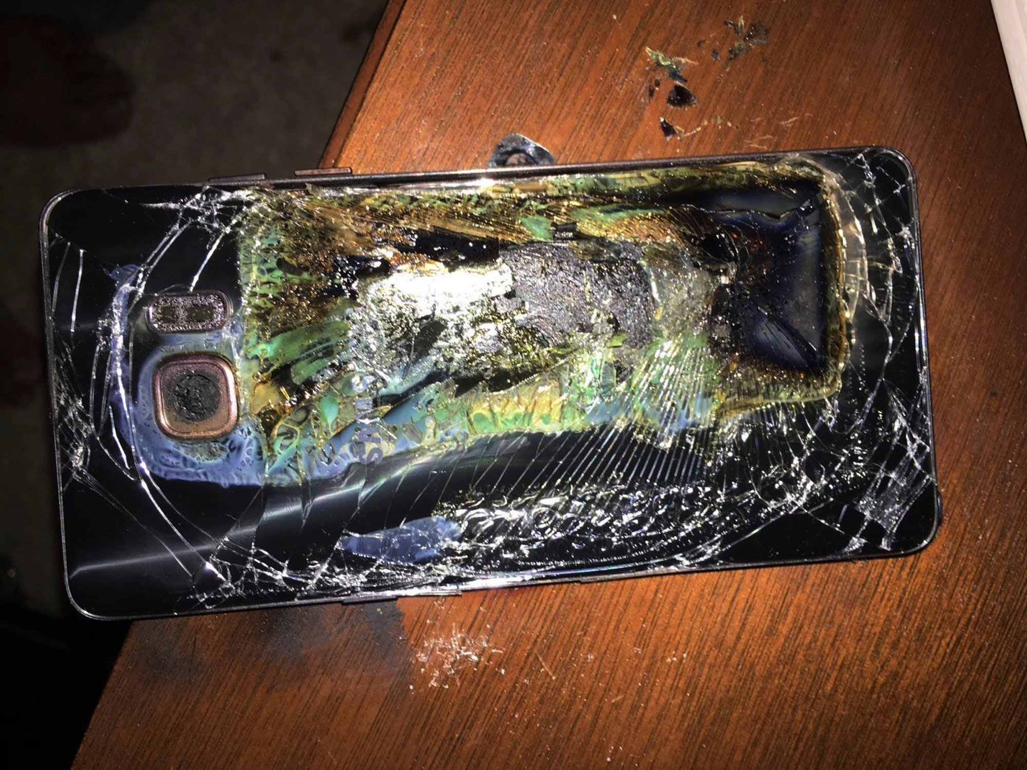 This Sunday, Oct. 9, 2016, file photo shows a damaged Samsung Galaxy Note 7 on a table in Richmond, Va., after it caught fire earlier in the day. (Source: Shawn L. Minter via AP, File)
