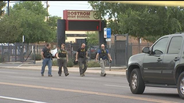 Phoenix Police officers walking as Bostrom was on lockdown Friday morning. (Source: 3TV/CBS5)