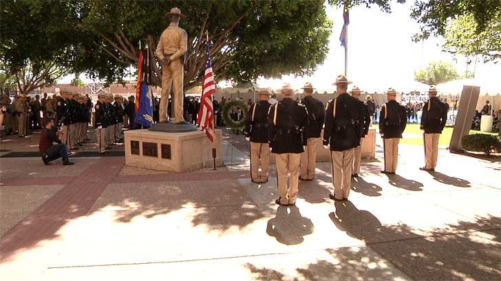 Family members and friends remember the 29 fallen officers. (Source: 3TV/CBS 5)