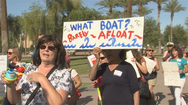 Teachers dressed as boat captains and dragged inflatable rafts to the Capitol grounds. (Source: 3TV/CBS 5)
