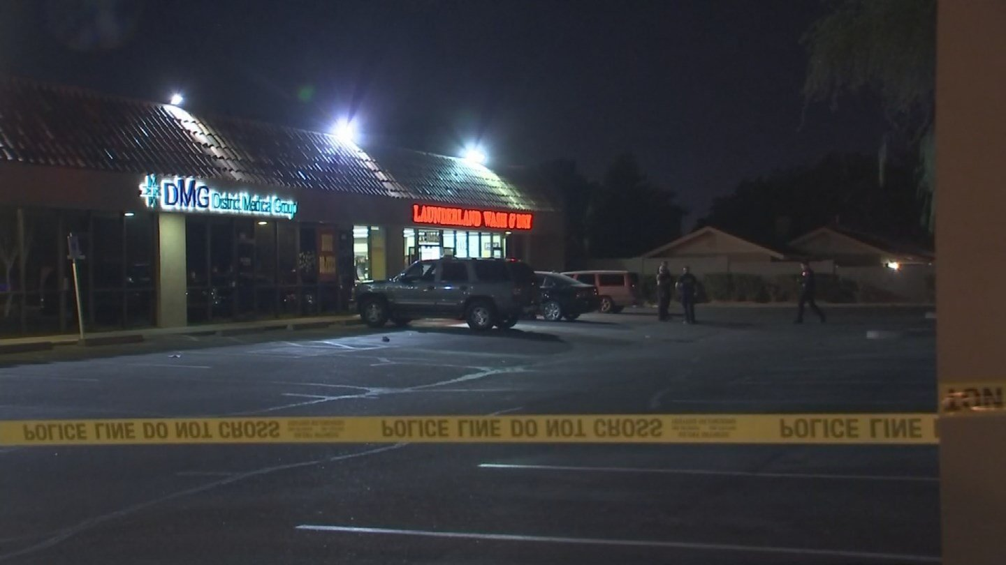 Police investigate the crime scene outside of the laundromat (Source: 3TV/CBS 5)