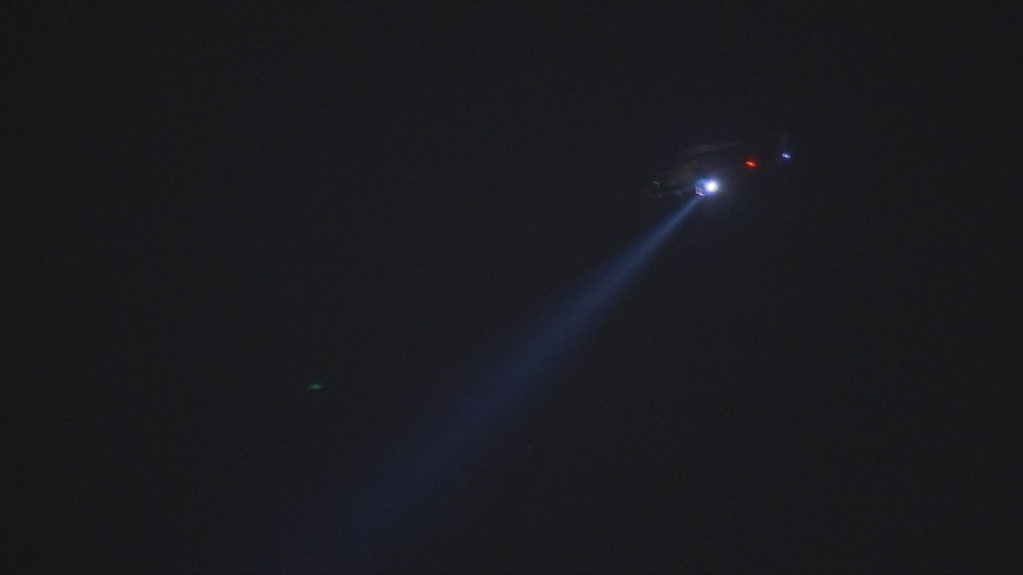 A police helicopter spotlights the crime scene (Source: 3TV/CBS 5)