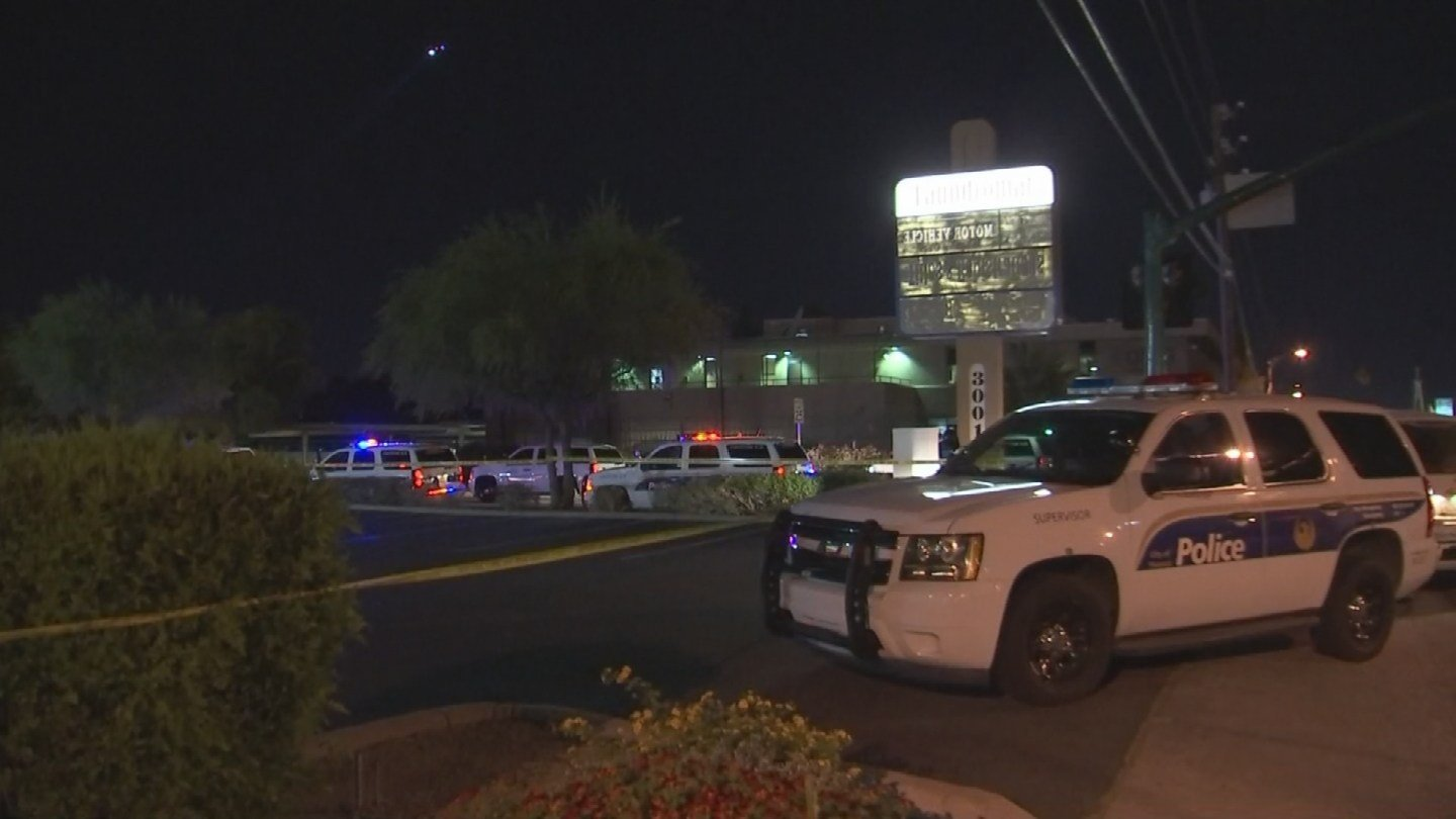 Police vehicles sit outside the laundromat (Source: 3TV/CBS 5)