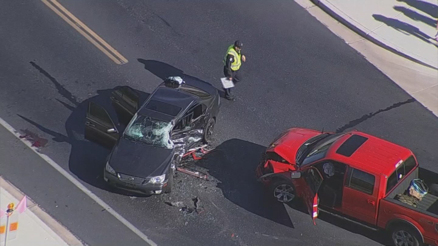 Aerial video from the scene showed a red pickup truck and a four-door car with its driver's side caved in. (Source: 3TV/CBS 5)