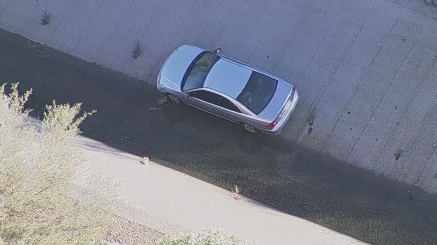 A vehicle went into the canal after experiencing tire failure. (Source: 3TV/CBS 5)