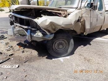 The pickup truck driver, 73-year-old William Frakes, was taken to the hospital with a broken ankle, some cuts and bruises. (Source: Mohave County Sheriff's Office)