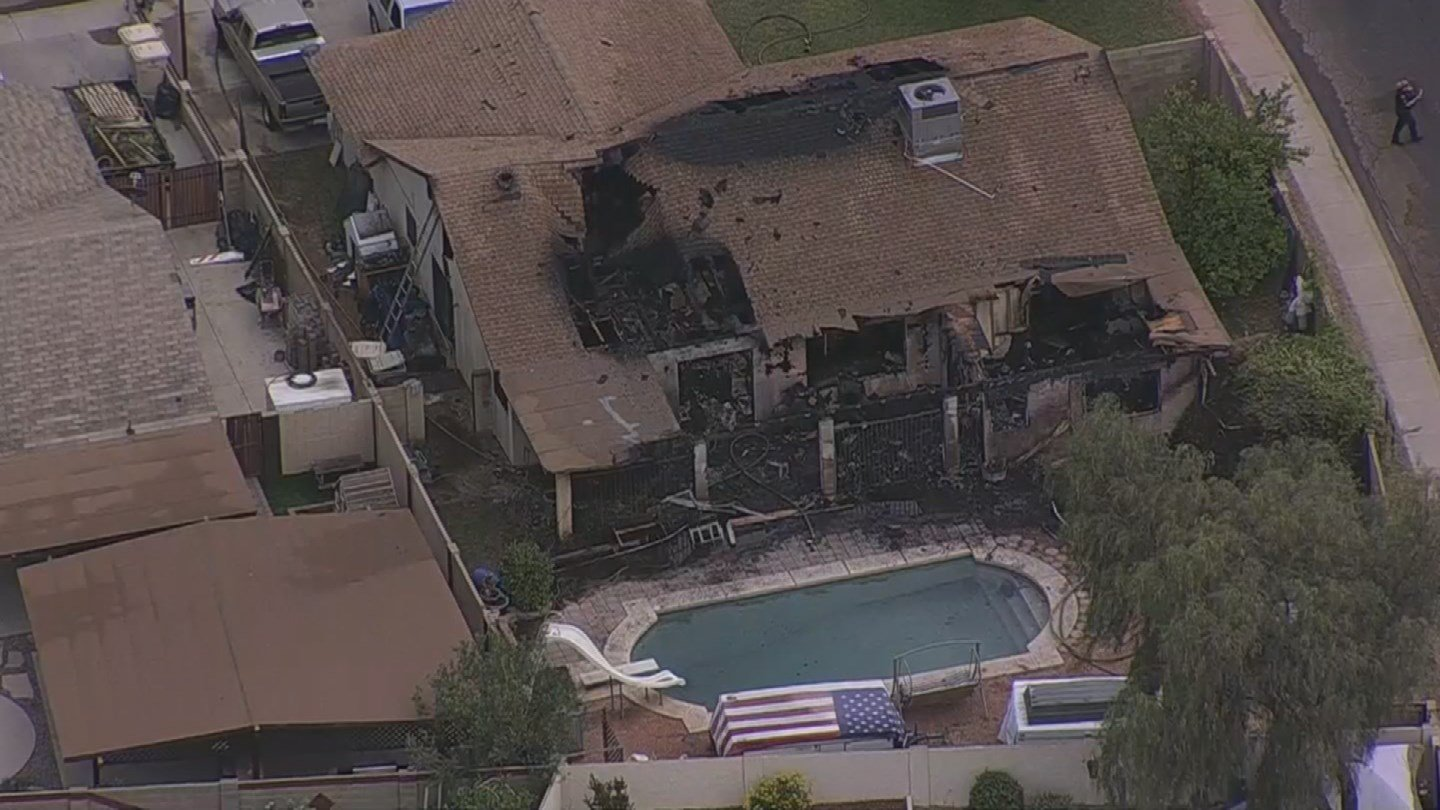 Firefighters were battling a house fire near 81st Avenue and McLellan Road. (Source: 3TV/CBS 5)