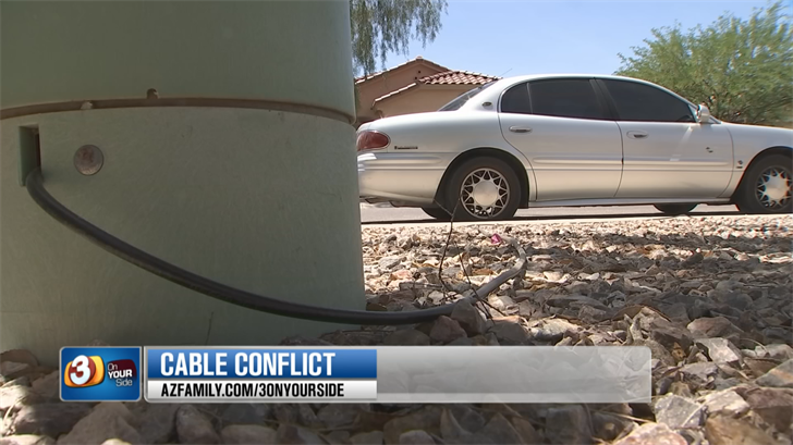 Susan Miller was upset over a cable line that was strewn across her property and extended all the way down her sidewalk. (Source: 3TV/CBS 5)