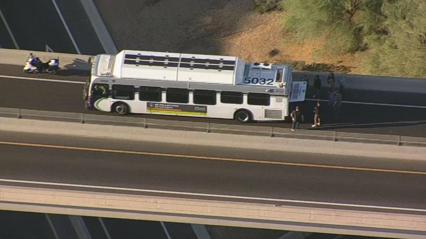 Drivers assisted with DPS to push a Valley Metro bus out of the roadway. (SOURCE: 3TV/CBS5)